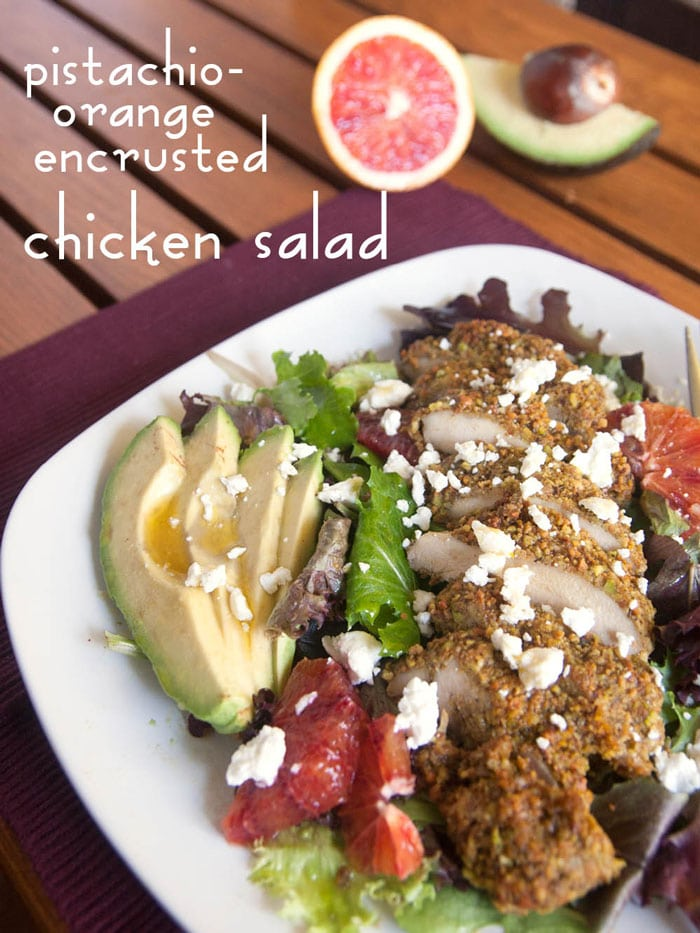 Pistachio-orange encrusted chicken salad - Simple to make with a complex taste! Aromatic orange and pistachio complements the chicken, while the pungent and tangy goat cheese balances out the sweetness of the dressing. | pinchmeimeating.com
