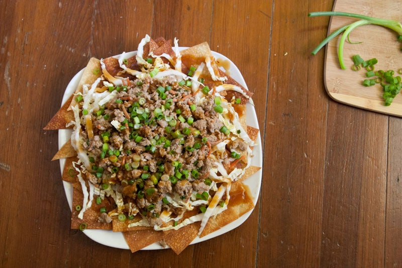 Potsticker Nachos with Baked Sesame Ginger Wonton Chips | Enjoy the juicy, gingery gyoza filling in a crunchy, fun, easy-to-share format. These Asian-inspired nachos are sure to be a hit! | www.pinchmeimeating.com
