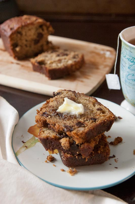 The moistest, meltiest, most delicious chocolate chip banana nut bread you'll ever taste. In the oven in only 20 minutes, and it's great for breakfast AND dessert! | www.pinchmeimeating.com