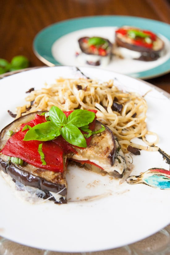 These grilled balsamic eggplant stacks are full of oh-so-melty mozzarella cheese, smoky roasted red peppers, and basil, and are perfect for a light dinner! | www.pinchmeimeating.com