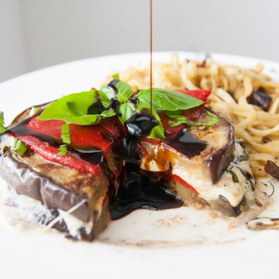 Vegetarian and grain-free, these grilled balsamic eggplant stacks are full of oh-so-melty mozzarella cheese, smoky roasted red peppers, and basil, and are perfect for a light dinner! | www.pinchmeimeating.com