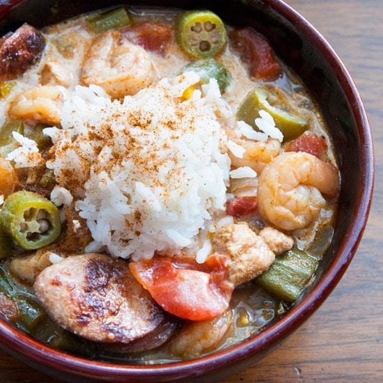 With chicken, shrimp, spicy andouille sausage, okra, and tons of other veggies, this gumbo is packed with FLAVOR and serves a crowd! | www.pinchmeimeating.com