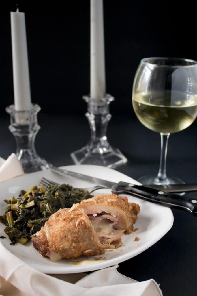 With ham, swiss, and a flavorful breading, this easy chicken cordon bleu is simple enough to make on a weeknight and fancy enough for a romantic Valentine's Day dinner! You can even make ahead of time and bake the day of. It's so juicy and flavorful! | www.pinchmeimeating.com