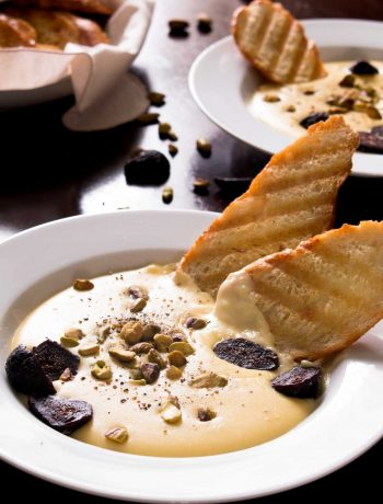 Smoked Gouda and Provolone Piccante Fonduta with Figs and Pistachios - a hot, smoky Italian cheese dip perfect for dipping bread and dried fruit. The Italian version of French fondue, made with milk and egg yolks instead of wine and cornstarch. It's the perfect romantic appetizer, and is both beautiful and simple to whip up! | www.pinchmeimeating.com