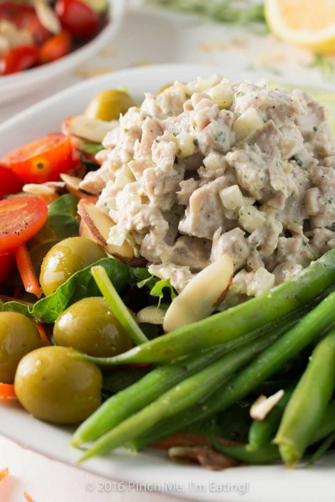 Inspired by a salad from the historic district of Old Montreal, this dinner salad is light, fresh, and perfect for dining al fresco at your own home! Topped with lemon tarragon chicken salad and a champagne vinaigrette. | www.pinchmeimeating.com