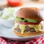 These juicy, aromatic gourmet turkey burgers topped with tomato, avocado, and Hollandaise sauce will make you feel like you're relaxing at an outdoor cafe!   www.pinchmeimeating.com
