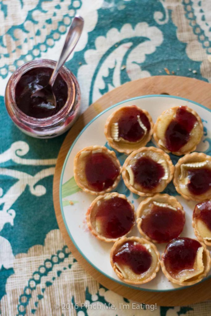 Bite-sized jam and brie tartlets combine melty cheese and your favorite jam for an irresistibly adorable appetizer you can serve at your next wine and cheese party. You'll have a hard time saving some of these canapés for your guests! This recipe uses Brazilian jabuticaba jam, but you can use your favorite kind or even multiple flavors of jam for a variety plate! | www.pinchmeimeating.com