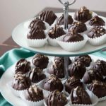 Chocolate covered coconut truffles with Brazil nut or almond butter are a rich, decadent, and easy gourmet dessert perfect for parties (or for treating yourself)! Best of all, you can make this recipe in advance! You can also use cashew butter or macadamia nut butter. | www.pinchmeimeating.com
