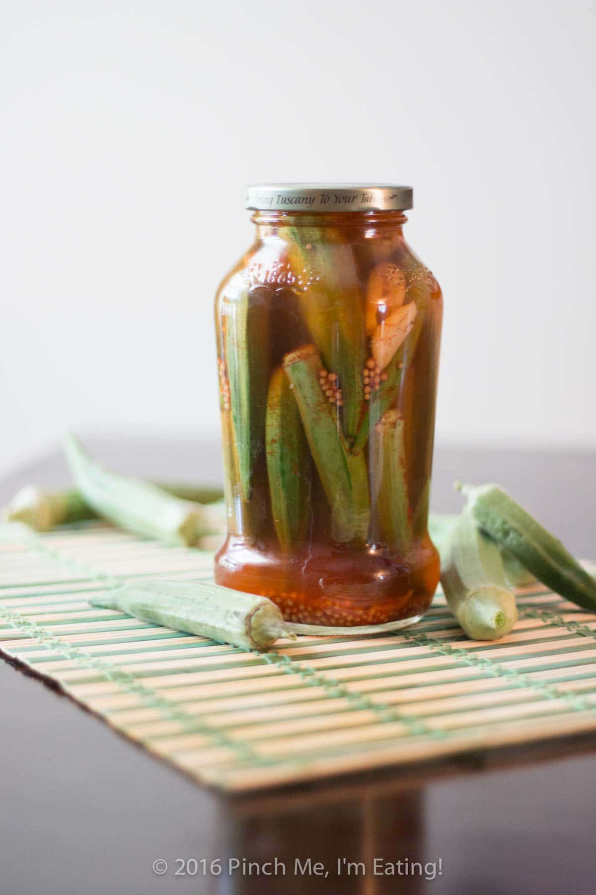Easy refrigerator pickled okra is perfect for small batches! No canning experience necessary. Make these okra pickles two ways — sweet and tangy or hot and smoky! | www.pinchmeimeating.com