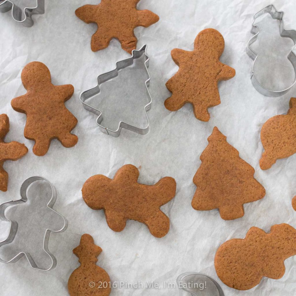 Overhead view of chewy gingerbread men, gingerbread girls, Christmas trees and snowmen with cookie cutters