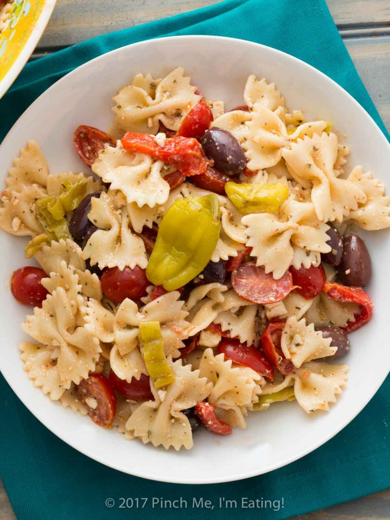 Greek bowtie pasta salad in a white bowl