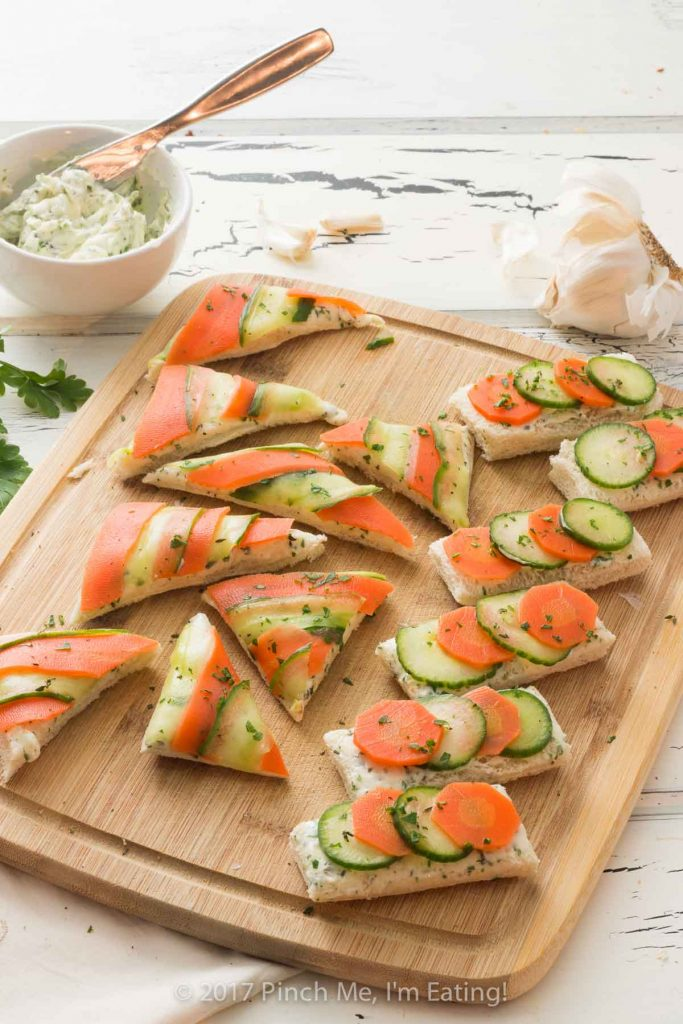 Open-faced marinated carrot and cucumber tea sandwiches with garlic herb butter are a beautiful and colorful twist on the quintessential finger sandwich!
