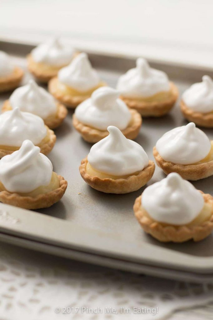 These bite-sized mini lemon meringue pies are a charming and adorable dessert for a springtime or Mother's Day tea party! You can use homemade or store-bought lemon curd. | How to use lemon curd | Mother's Day desserts | Afternoon tea desserts | Afternoon tea recipes