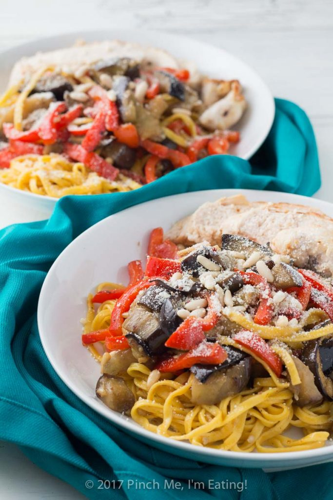 Saffron pasta with eggplant, chicken, bell pepper, and pine nuts may look fancy, but it comes together very easily for a simple weeknight dinner!