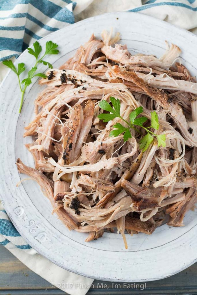 Slow cooker root beer pulled pork is juicy, flavorful, and provides the perfect base for mixing in your favorite barbecue sauce or using in other recipes! Takes only 5 minutes to prep.
