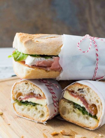 This dreamy prosciutto and brie sandwich with fig orange spread on a baguette will make you feel like you're in France!