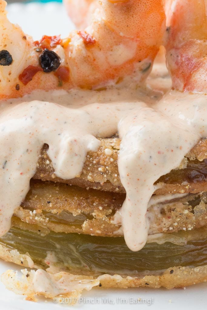 Closeup: fried green tomatoes with Cajun remoulade and pickled shrimp combine into a tangy, spicy, and crispy Southern dish you can use as an appetizer, side dish, or entrée!