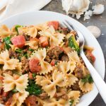 Italian sausage pasta with tomato cream sauce is an easy, cozy weeknight dinner the whole family will love! I like to make a batch of this flavorful comfort food and enjoy the leftovers all week!