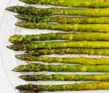 This simply prepared sweet onion oven roasted asparagus is a flavorful side dish that takes no time to whip up for a casual weeknight dinner and is elegant enough for company!