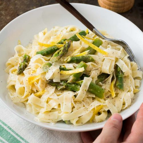 This creamy lemon pasta is simple to make yet decadent, punctuated by thin strips of lemon zest and tender-crisp asparagus pieces to ring in spring flavors!