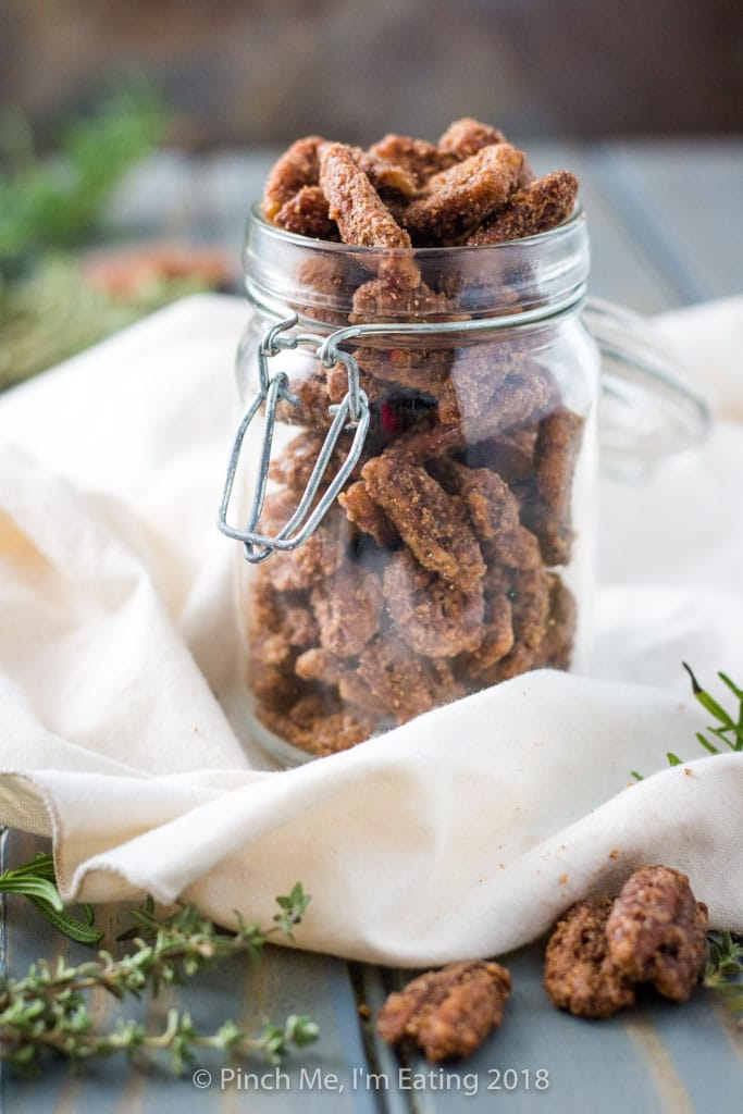 Candied pecans in an open jar
