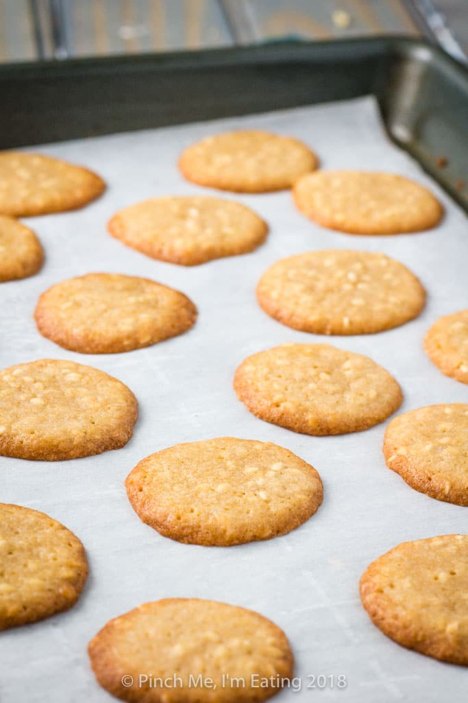 Benne wafers on parchment-lined cookie sheet