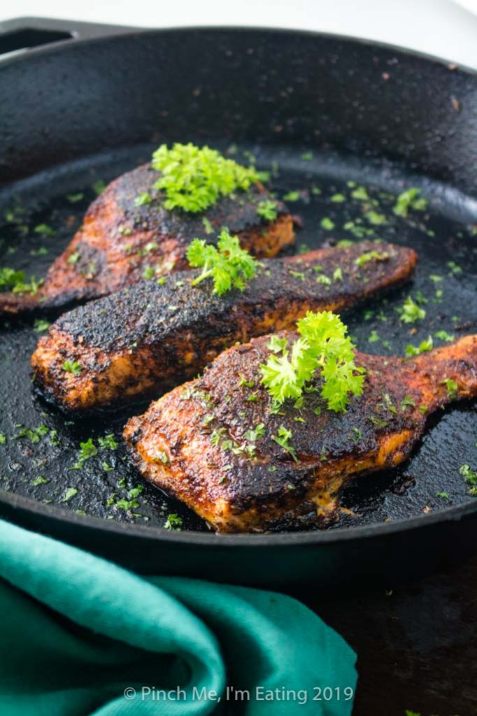 Blackened salmon fillets in cast iron skillet