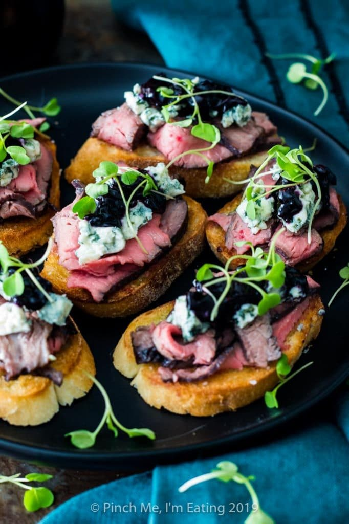 Blue cheese and steak crostini with blueberry caramelized onion jam