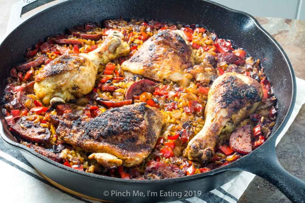Chicken and chorizo paella in a cast iron skillet