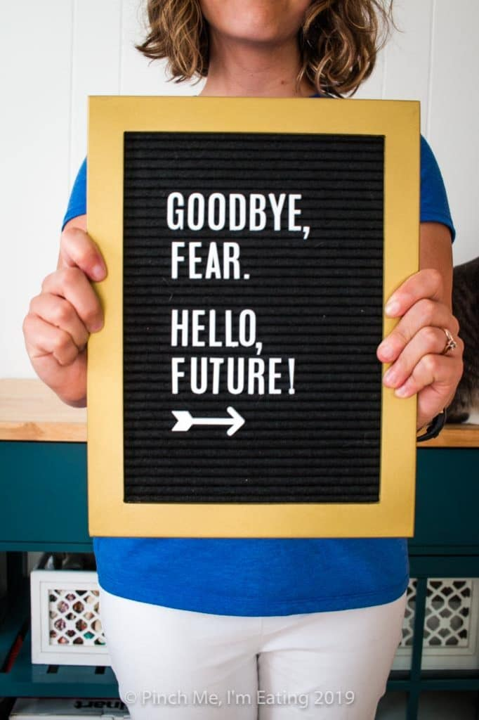 "Letterboard saying ""Goodbye, Fear. Hello, Future!"""
