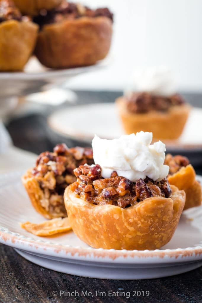 Mini pecan pie with whipped cream