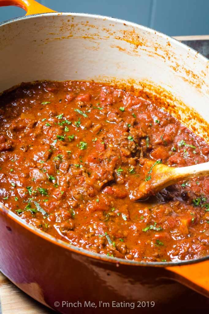 Homemade tomato meat sauce in a Dutch oven