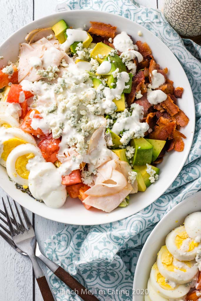 Overhead shot of turkey Cobb salad in a white dish