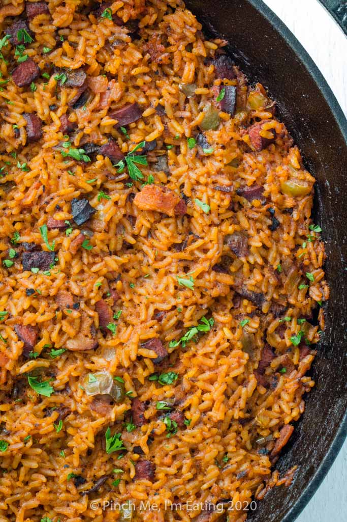 Closeup overhead view of Charleston red rice in a cast iron skillet