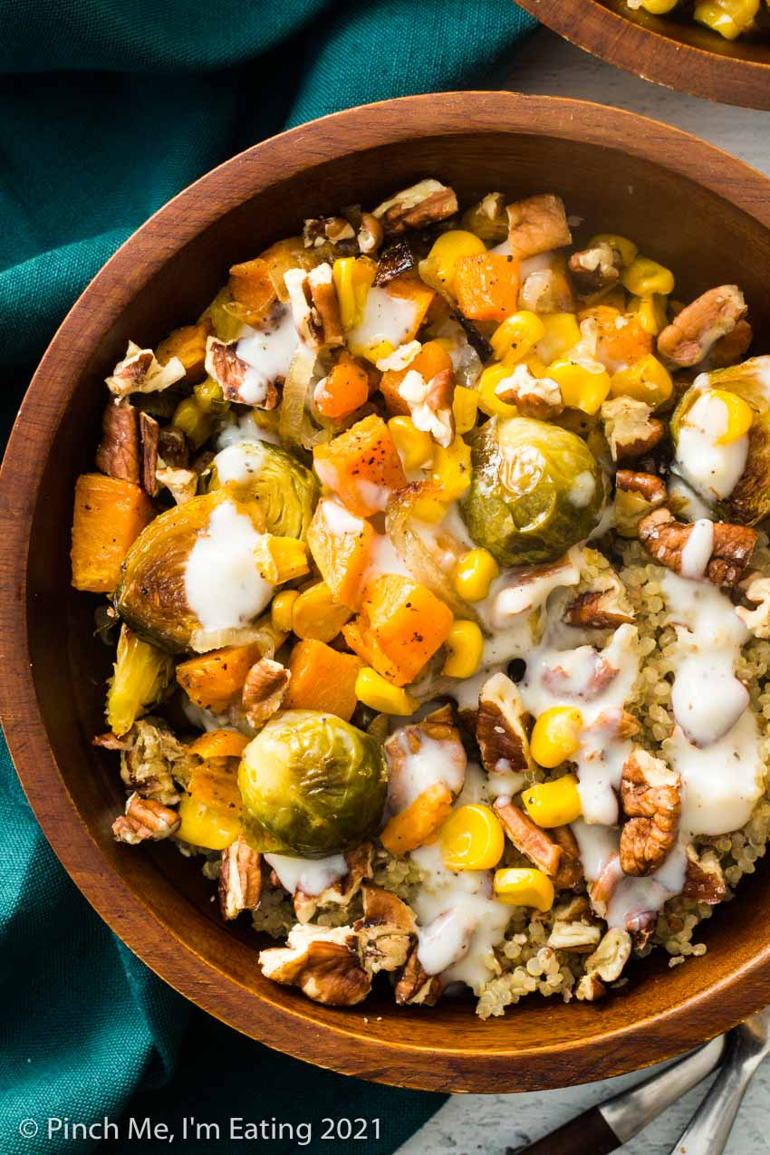 Roasted Vegetable and Quinoa Harvest Bowls with Creamy Mozzarella Sauce and Pecans