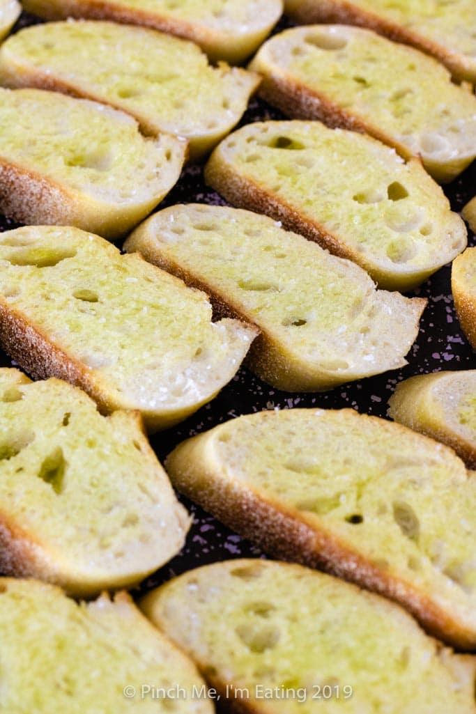 Close up of crostini toasts on baking sheet
