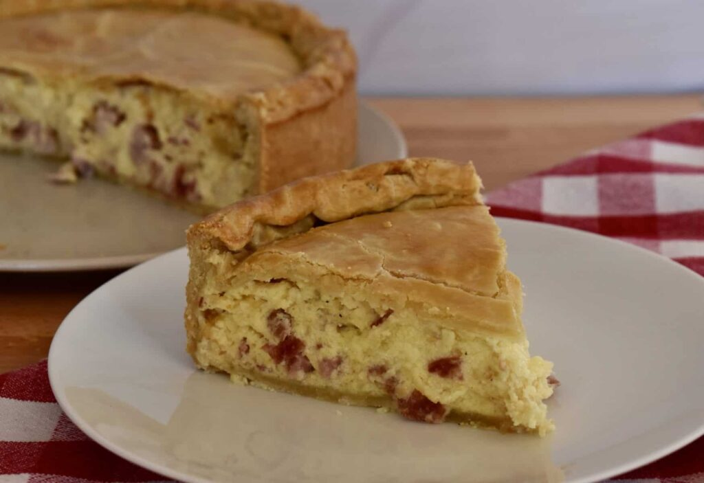 Pizza rustica on a white plate