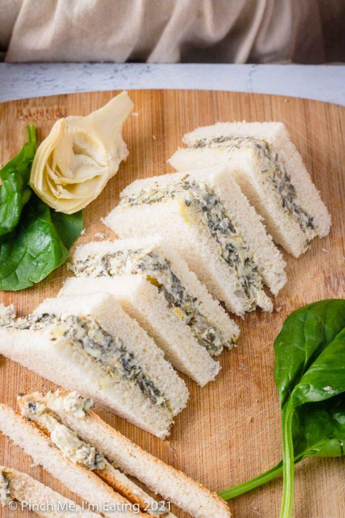 Four triangular artichoke spinach tea sandwiches