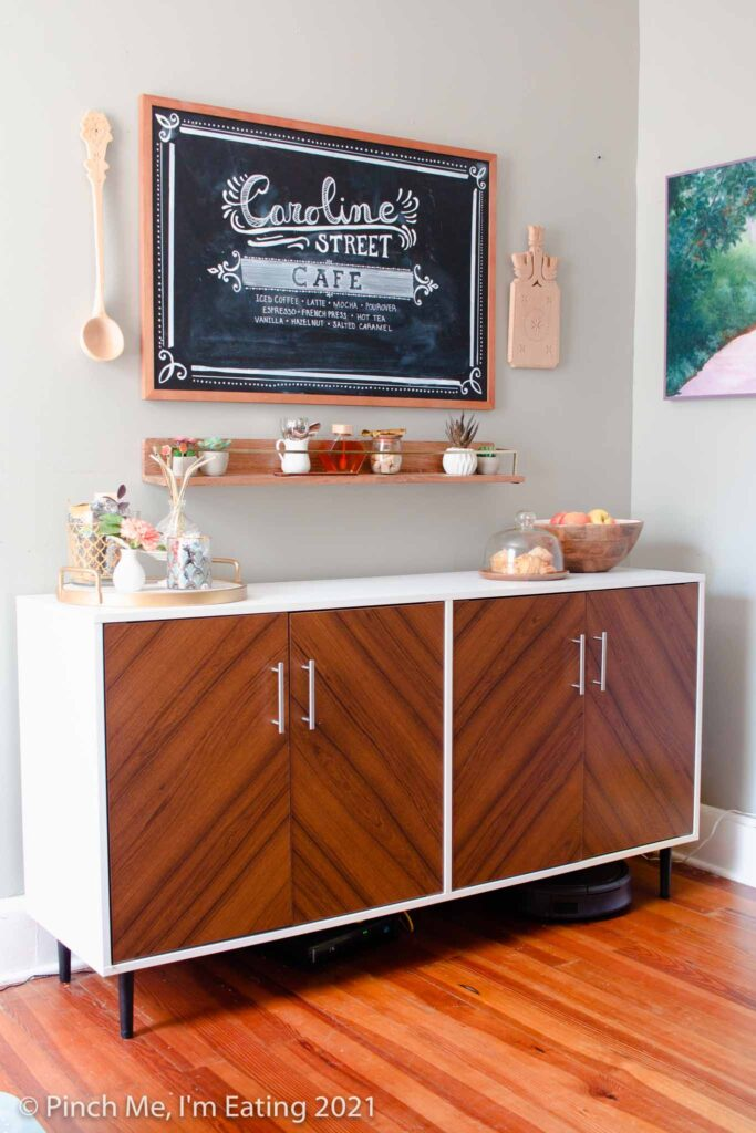 DIY at-home coffee station ideas - coffee bar on dining room buffet with fruit and pastry display, floating shelf, and menu chalkboard