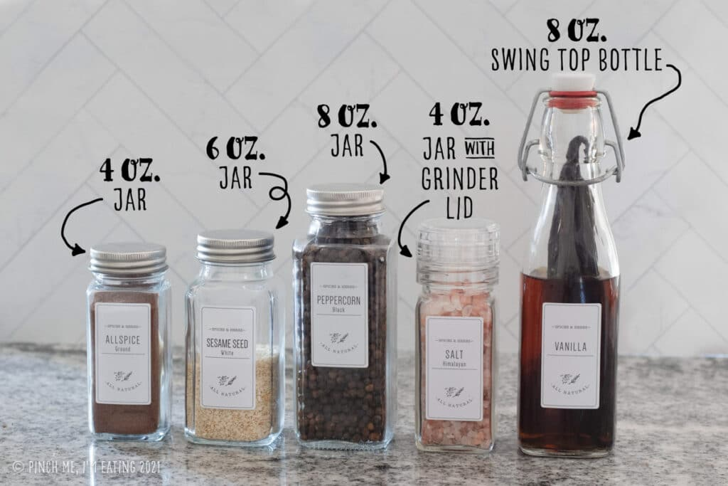 Labeled photo of different sizes of glass spice jars with white labels