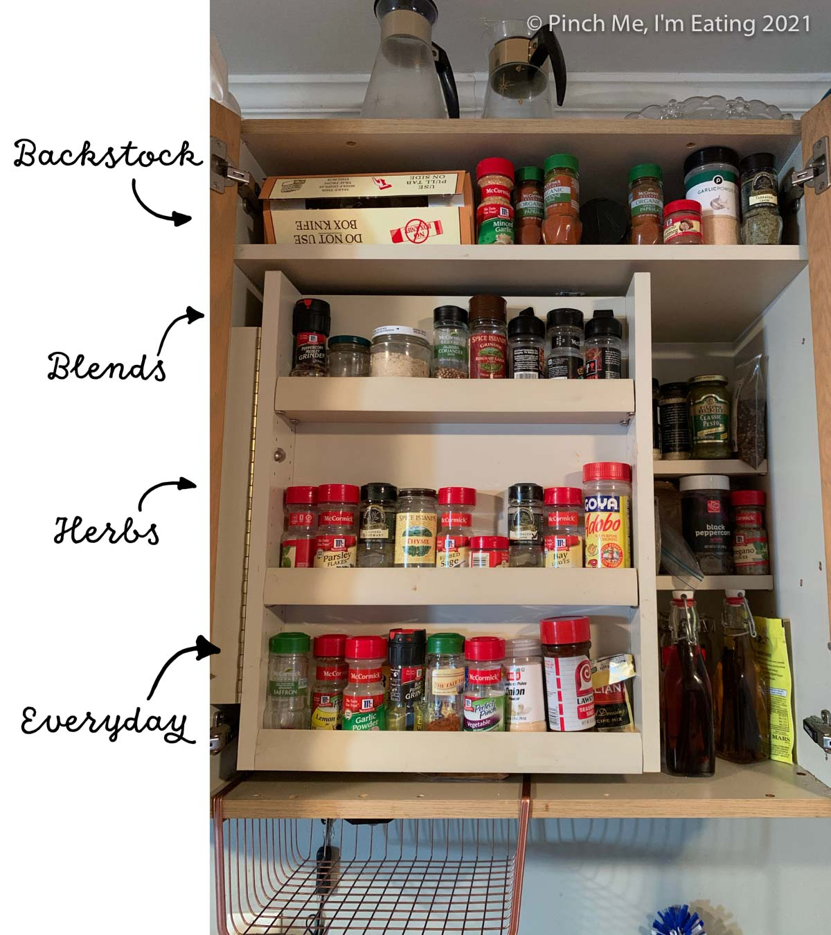 Cabinet with swinging spice shelf insert - labeled with organization